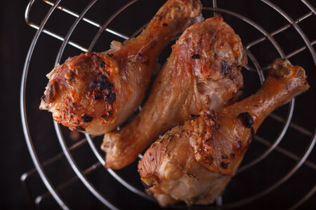 Grilled chicken legs, black background photo