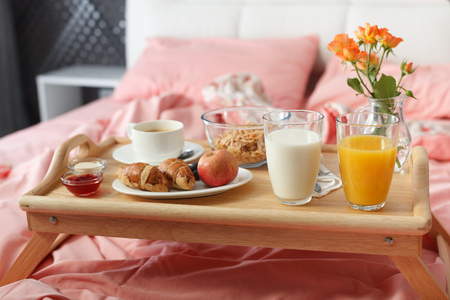 continental: Breakfast served in bed on wooden tray with coffee and croissants