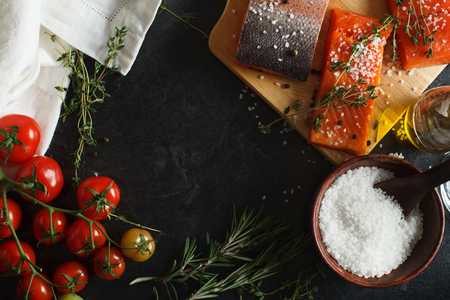 filets: Overhead view of Salmon filets served on wooden cutting board. Copyspace Stock Photo