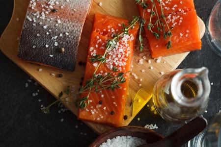 filets: Salmon filets served on wooden cutting board Stock Photo