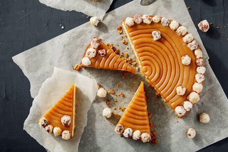 cutted: Overview of cutted homemade pie with nuts and caramel. Rustic style. Stock Image