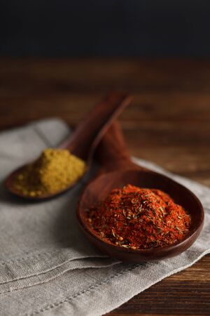 seasonings: Fragrant seasonings and spices on wooden spoon. Stock Image.