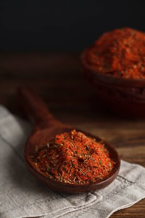 seasonings: Red seasonings on wooden spoon. Stock Image.