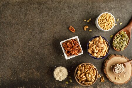 Frame made of different types of nuts in bowls. Top view. Copy space 版權商用圖片