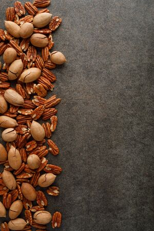 Frame of pecan nuts on marble background. Top view. Copy space