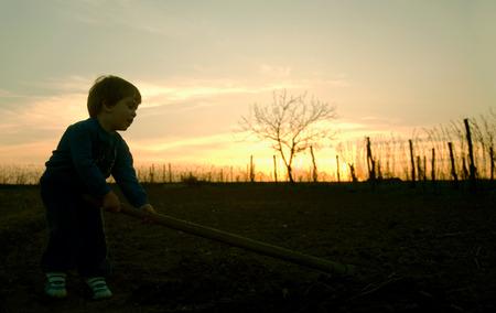 digging: Little boy digging Stock Photo