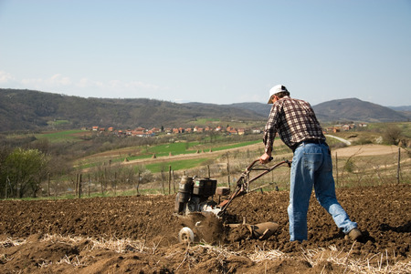 agricultural tools: Man with tiller