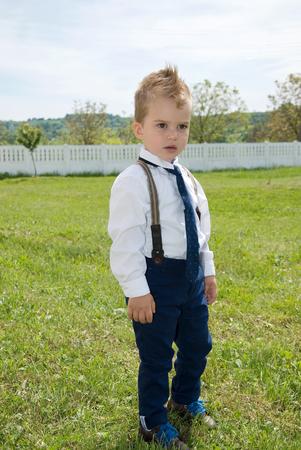 solemn: Little boy in solemn clothes