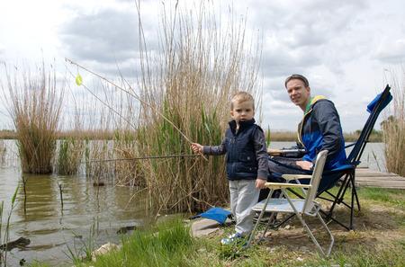 upbringing: Dad and son fishing