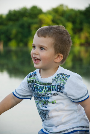 Smiling boy near the lake Stok Fotoğraf
