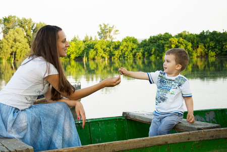 Little boy and mom in the boat