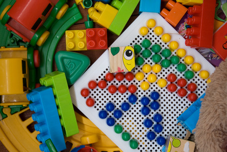 plastic toys on a wooden base