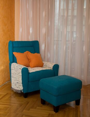 footstool: Armchair and footstool turquoise Stock Photo