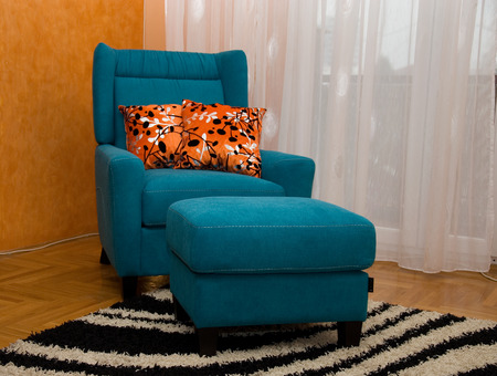 Armchair and footstool turquoise Stok Fotoğraf