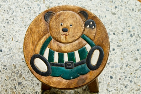 bear on wood chair
