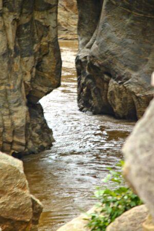 tropical stream between cliffs