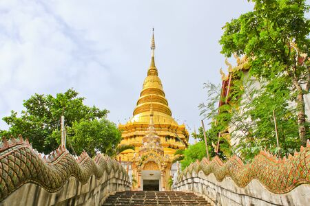 stair up to golden pagoda Stock Photo