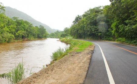 road with stream in country