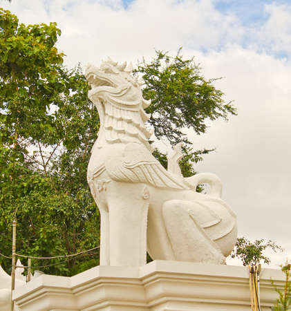white lion sculpture at entrance
