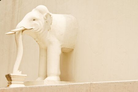 white elephant sculpture in pagoda
