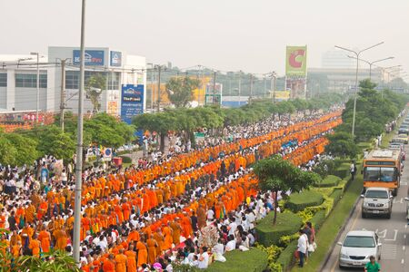 row of Buddhist monks in the morning