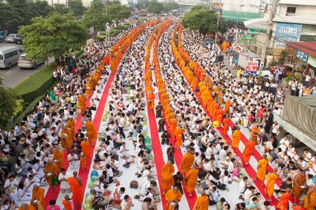 giveing alms to buddhist monks ceremony