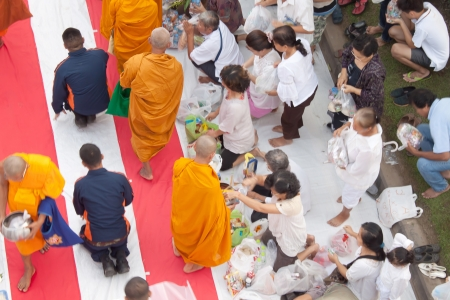 giving alms to monks  Editorial