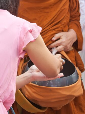 give for alms to monk Stock Photo