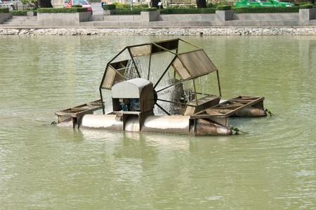 water wheel in pond