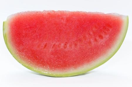 Een stuk van watermeloen, zonder zaden geà ¯ soleerd op witte achtergrond.