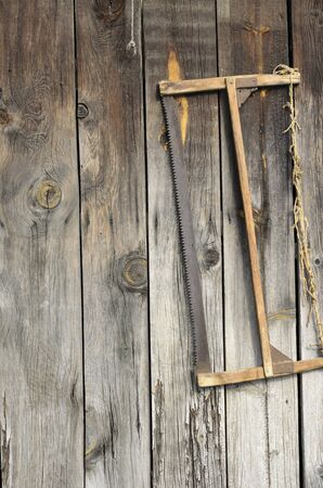 The old saw hanging on an ancient shed Stock Photo
