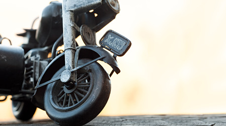 Close-up of miniature toy motorcycle on natural background photo