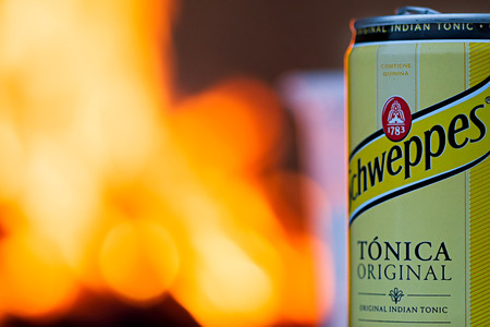 dewed: Schweppes can with fire in the background.