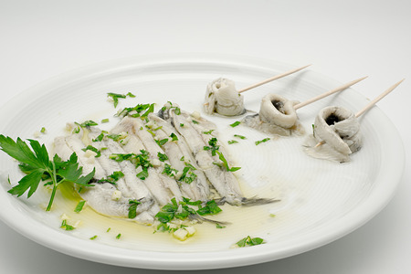 Marinated anchovies in vinegar and olive oil Stock Photo