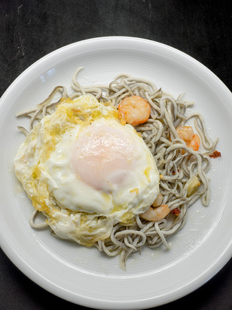 ajillo: Baby eels or elver substitute in garlic sauce a traditional Spanish tapas. Gulas al ajillo with prawns and fried egg.