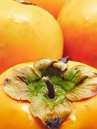 tacky: Close up of persimmons. Selective focus