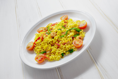 red food: Dish of noodles with prawns and vegetables