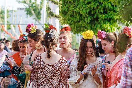 Seville, Spain - April 28, 2015: Young women wearing traditional flamenco dress at the April Fair Seville . The Seville Fair