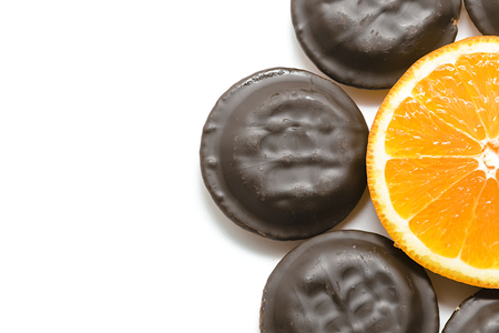 filled: Delicious Jaffa Cakes. Cookies covered with dark chocolate and filled with orange marmalade. Stock Photo