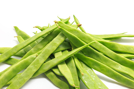 snap bean: Pile of italian flat green beans on a white background