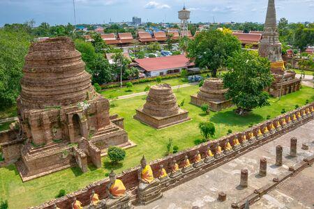 chaimongkol: Line of buddha statue in Wat Yai Chaimongkol , Ayutthaya , Thailand Stock Photo