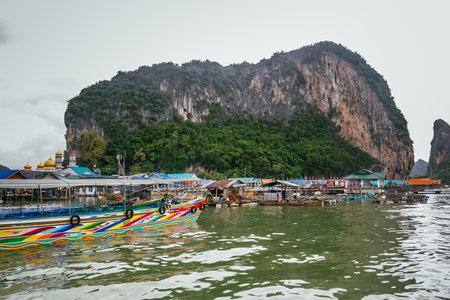 panyi: Phang Nga Bay, Thailand - July 30, 2014: Historical floating Koh Panyi settlement, also known as Koh Panyee, muslim fishing village built on stilts of Phang Nga Bay, Krabi, Thailand.