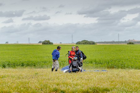 aerodrome: Seville, Spain - May 7, 2016: Skydiver Taking a Picture of Tandem after landing. Skydive Spain is the skydiving center located at La Juliana Aerodrome, about 20 km southwest of Seville, Spain. At Skydive Spain they fly up to 15,000ft, the highest altitude