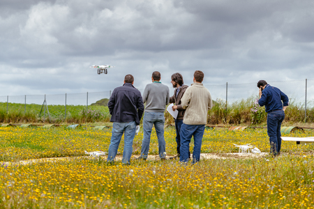 aerodrome: Seville, Spain - May 7, 2016: Group of persons making drone training course at La Juliana  Aerodrome. Skydive Spain is the skydiving center located at  La Juliana Aerodrome, about 20 km southwest of Seville, Spain. At Skydive Spain they fly up to 15,000ft