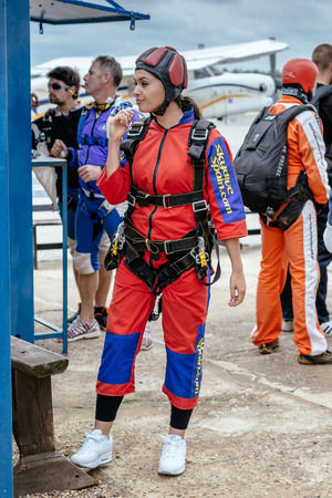 aerodrome: Seville, Spain - May 7, 2016: Beautiful woman prepares to skydive. Skydive Spain is the skydiving center located at La Juliana Aerodrome, about 20 km southwest of Seville, Spain. At Skydive Spain they fly up to 15,000ft, the highest altitude in Europe and