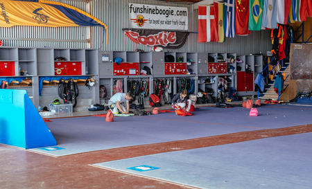 aerodrome: Seville, Spain - May 7, 2016: Group of skydivers preparing for jumping event, checking equipment. Skydive Spain preparation area. Skydive Spain is the skydiving center located at La Juliana Aerodrome, about 20 km southwest of Seville, Spain. At Skydive Sp