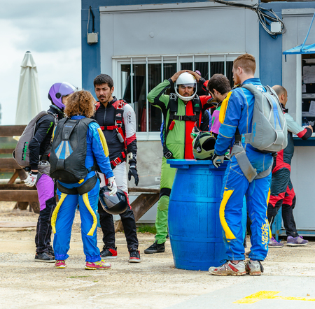 aerodrome: Seville, Spain - May 7, 2016: Group of skydivers preparing to fly. Skydive Spain is the skydiving center located at La Juliana Aerodrome, about 20 km southwest of Seville, Spain. At Skydive Spain they fly up to 15,000ft, the highest altitude in Europe and Editorial