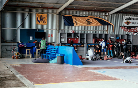 aerodrome: Seville, Spain - May 7, 2016: Group of skydivers preparing for jumping event, checking equipment. Skydive Spain preparation area. Skydive Spain is the skydiving center located at at La Juliana Aerodrome, about 20 km southwest of Seville, Spain. At Skydive