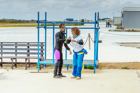 aerodrome: Seville, Spain - May 7, 2016: Skydiving instructor teaches her the correct skydiving position before jumping. Skydive Spain is the skydiving center located at La Juliana Aerodrome, about 20 km southwest of Seville, Spain. At Skydive Spain they fly up to 1
