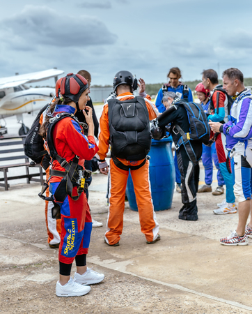 aerodrome: Seville, Spain - May 7, 2016: Group of skydivers prepaire to skydive. Skydive Spain is the skydiving center located at La Juliana Aerodrome, about 20 km southwest of Seville, Spain. At Skydive Spain they fly up to 15,000ft, the highest altitude in Europe  Editorial